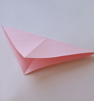 Согните лист по другой диагонали